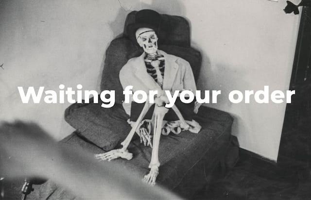 A skeleton sitting on a sofa