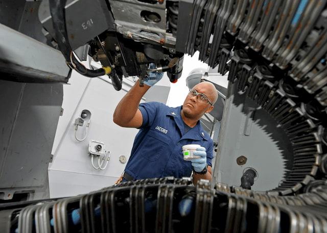 Man maintaining machine
