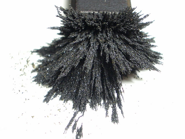 Metal powder attracted to magnet