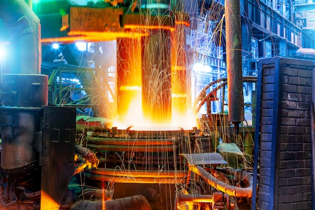 Electric arc furnace with sparks flying