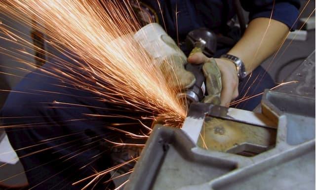 Man grinding metal
